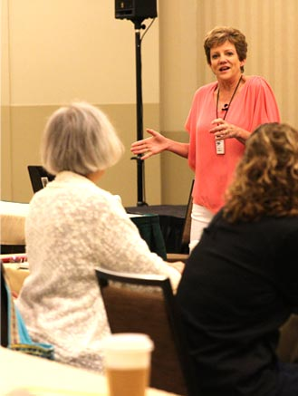 Laura Christianson teaches writers how to plan their websites at a conference   BloggingBistro.com